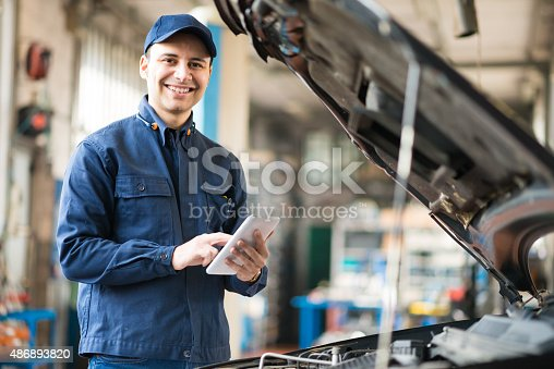 istock Mechanic using a tablet in his garage 486893820