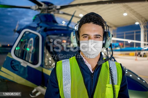istock Mechanic wearing a facemask while working at a heliport 1265082001