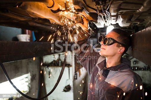 Mechanic welding in a ditch