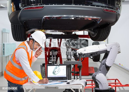 istock Mechanic with assistance robotic inspection wheel balancing of modern car in automotive industry 4.0 concept 808594908