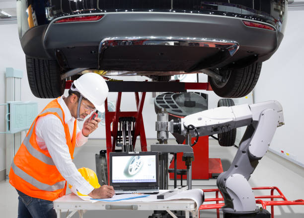 mechanic with assistance robotic inspection wheel balancing of modern car in automotive industry 4.0 concept - auto body repair stock photos and pictures