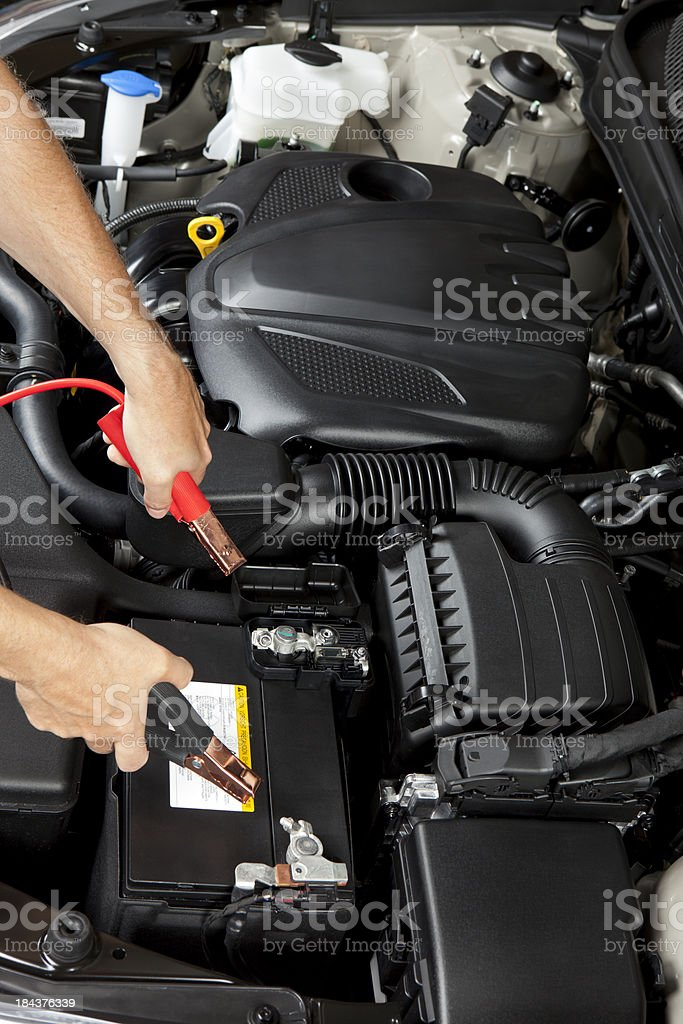 Mechanic with Jumper Cables stock photo