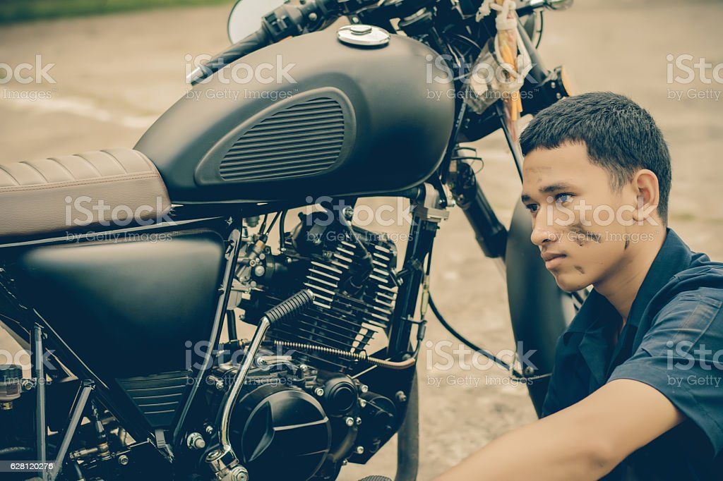 Mechanic with motorcycle .Vintage style. stock photo
