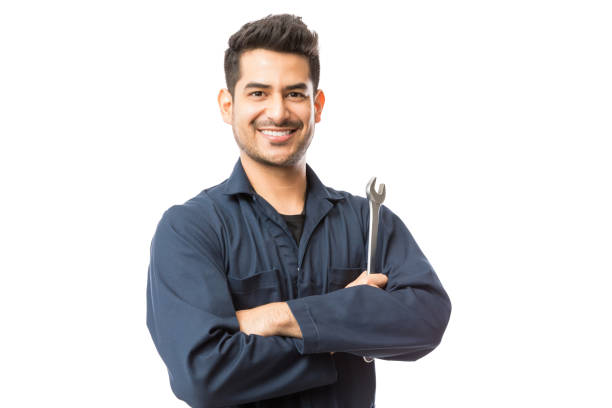Mechanic With Wrench Standing Hands Folded On White Background Smiling auto mechanic with wrench standing hands folded on white background repairman stock pictures, royalty-free photos & images