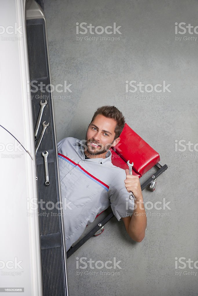 Mechanic With Wrench, Under Car stock photo