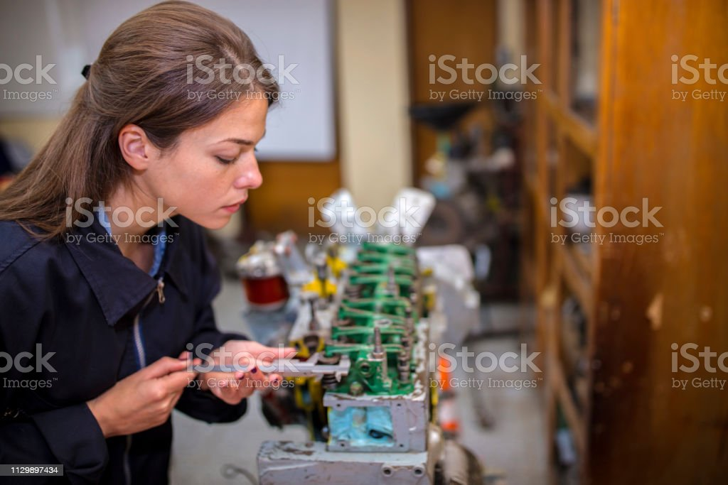 Mechanic woman in farm garage
