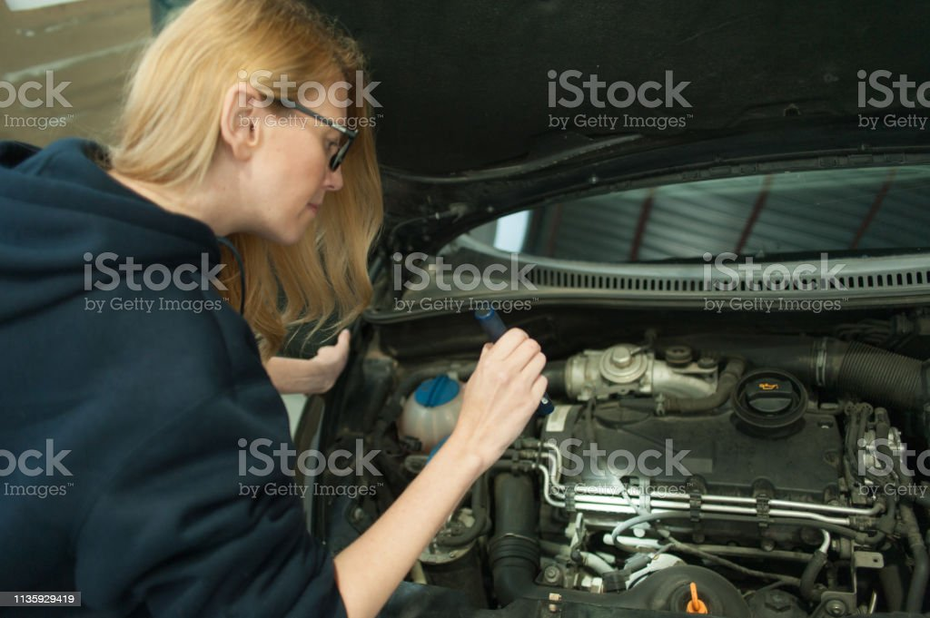 Mechanic woman car maintenance