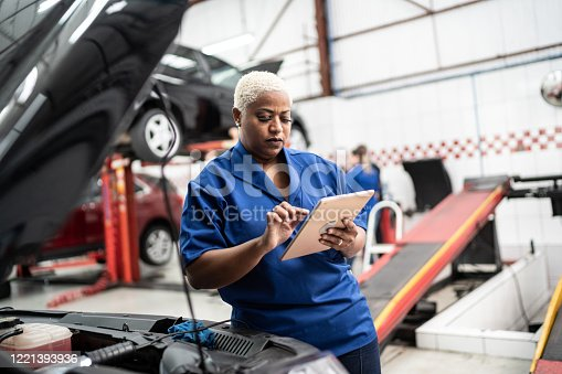 Car mechanics, workers, customers, satisfaction / Auto car repair service center.