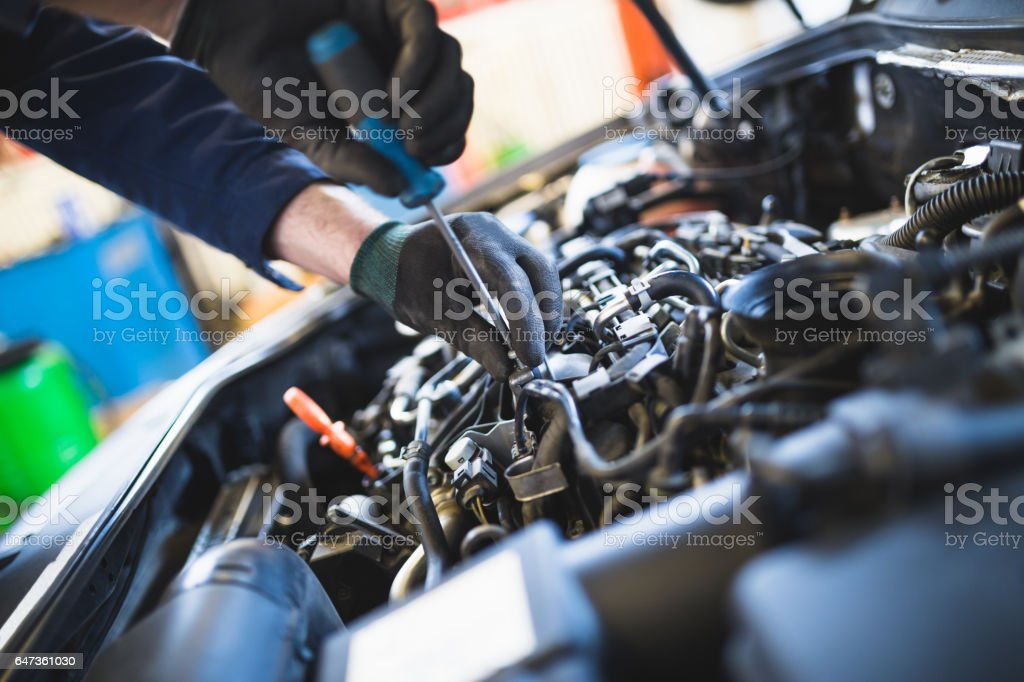 Mechanic worker hands close up stock photo