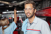istock Mechanic working at his auto body shop 171303716