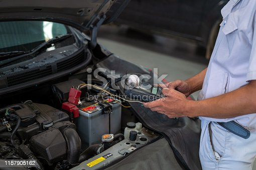 istock mechanic working car maintenance with soft-focus and over light in the background 1157905162