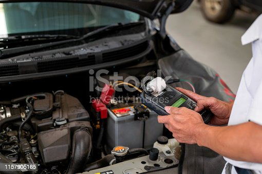istock mechanic working car maintenance with soft-focus and over light in the background 1157905165