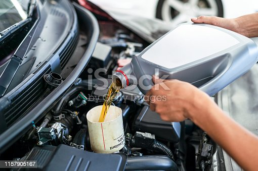 istock mechanic working car maintenance with soft-focus and over light in the background 1157905167