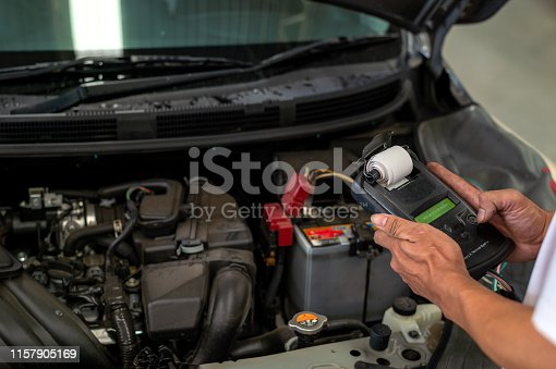 istock mechanic working car maintenance with soft-focus and over light in the background 1157905169