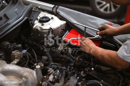 istock mechanic working car maintenance with soft-focus and over light in the background 1180216831
