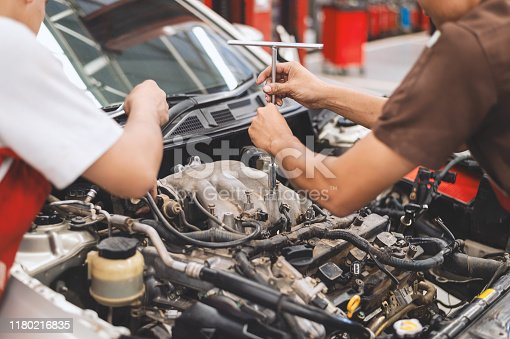 istock mechanic working car maintenance with soft-focus and over light in the background 1180216835