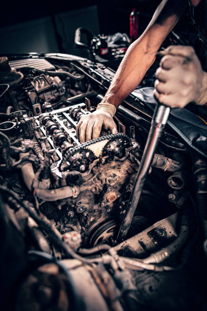Mechanic working in a car stock photo