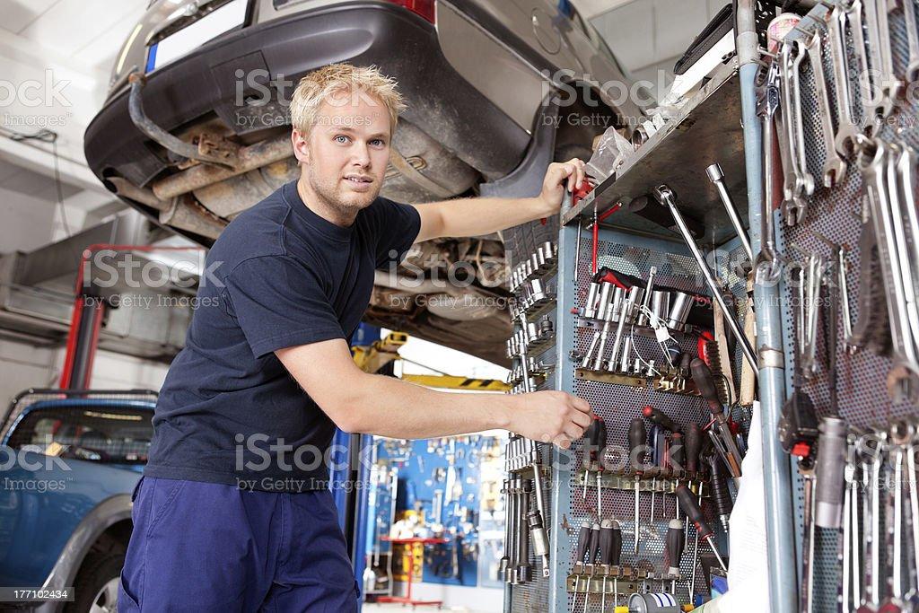 Mechanic Working in Garage royalty-free stock photo
