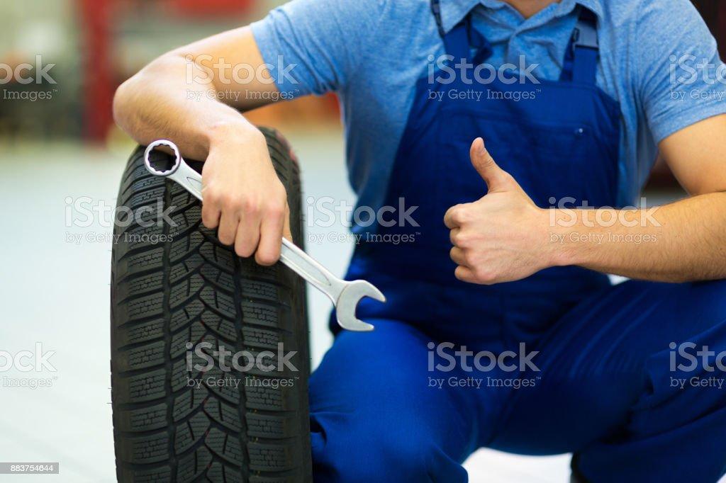 Mechanic working on a car stock photo