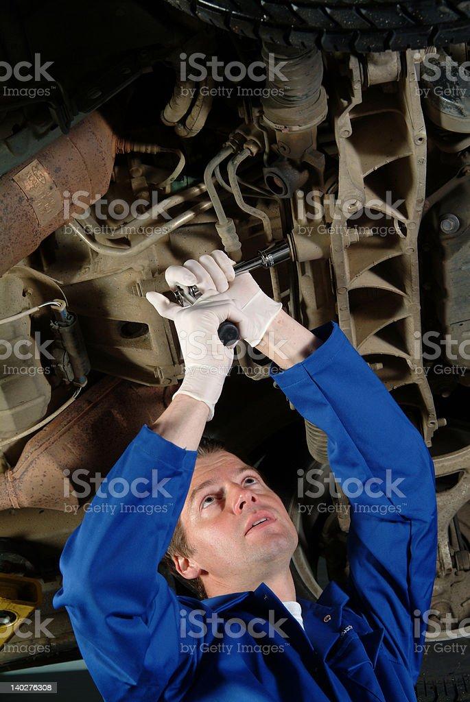 Mechanic working on a Jaguar car royalty-free stock photo