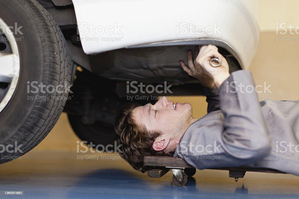 Mechanic working on car engine stock photo