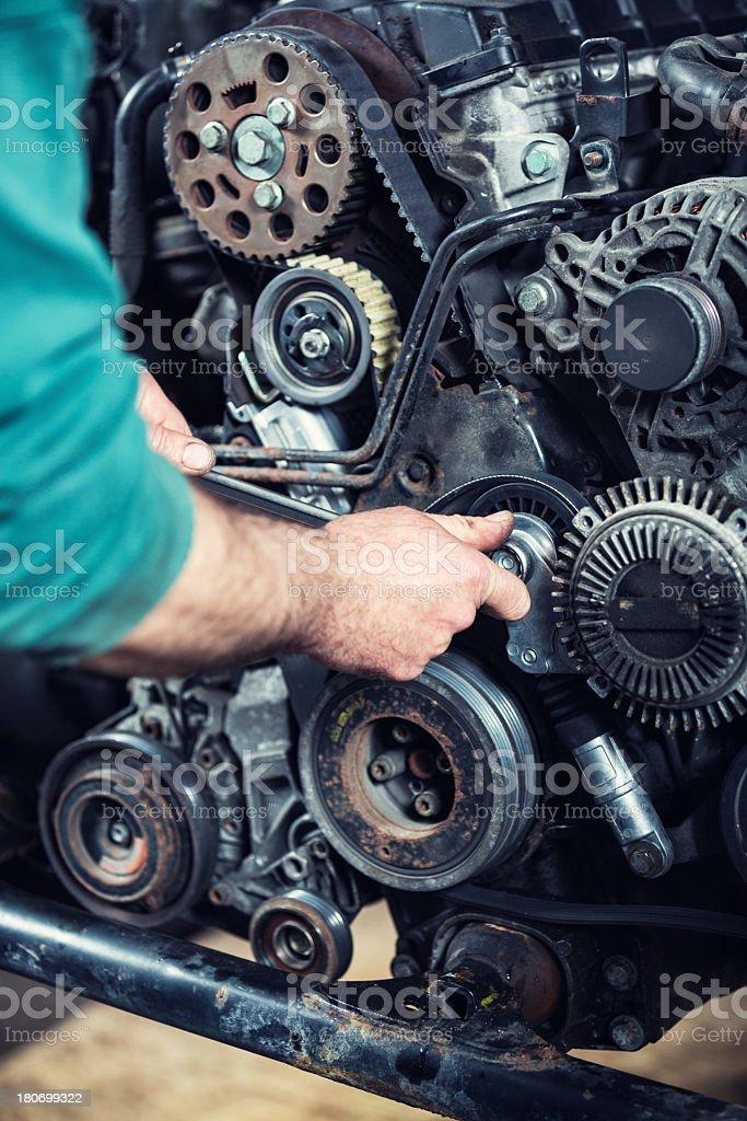 Mechanic working on car engine royalty-free stock photo