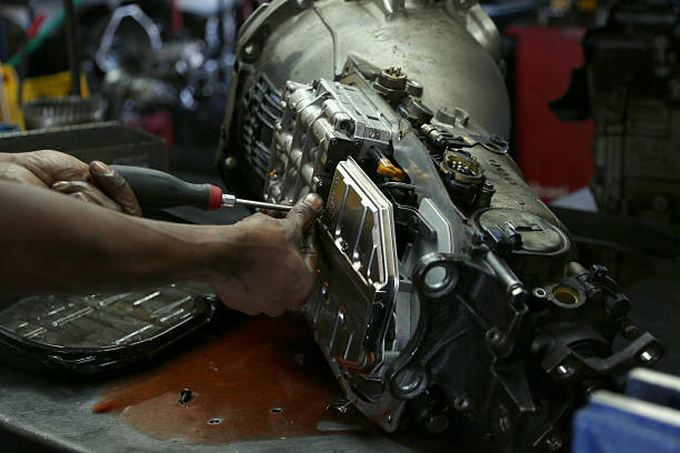 mechanic working on car transmission - communication stock pictures, royalty-free photos & images