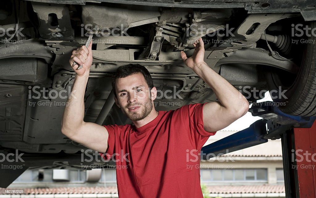 Mechanic working under car royalty-free stock photo