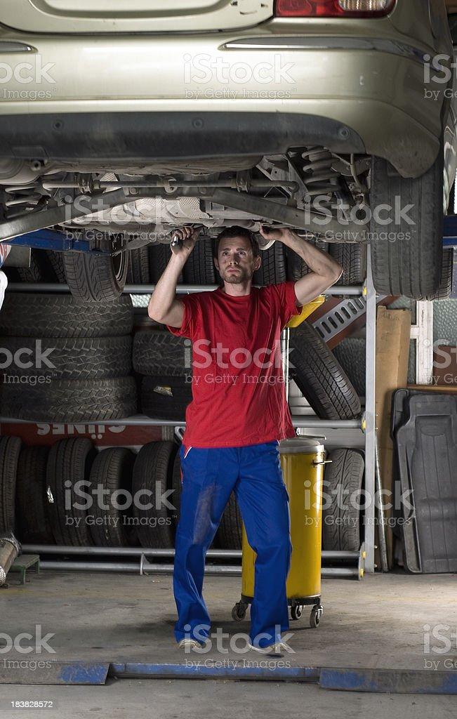 Mechanic working under car royalty-free stock photo
