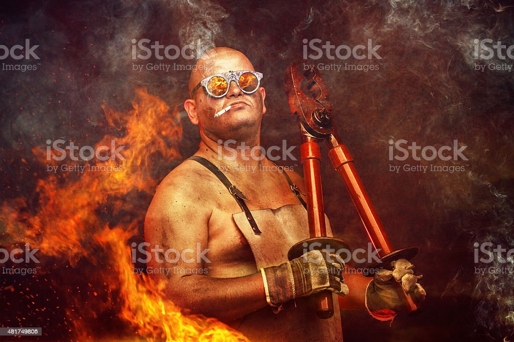 mechanic working with a huge plier stock photo