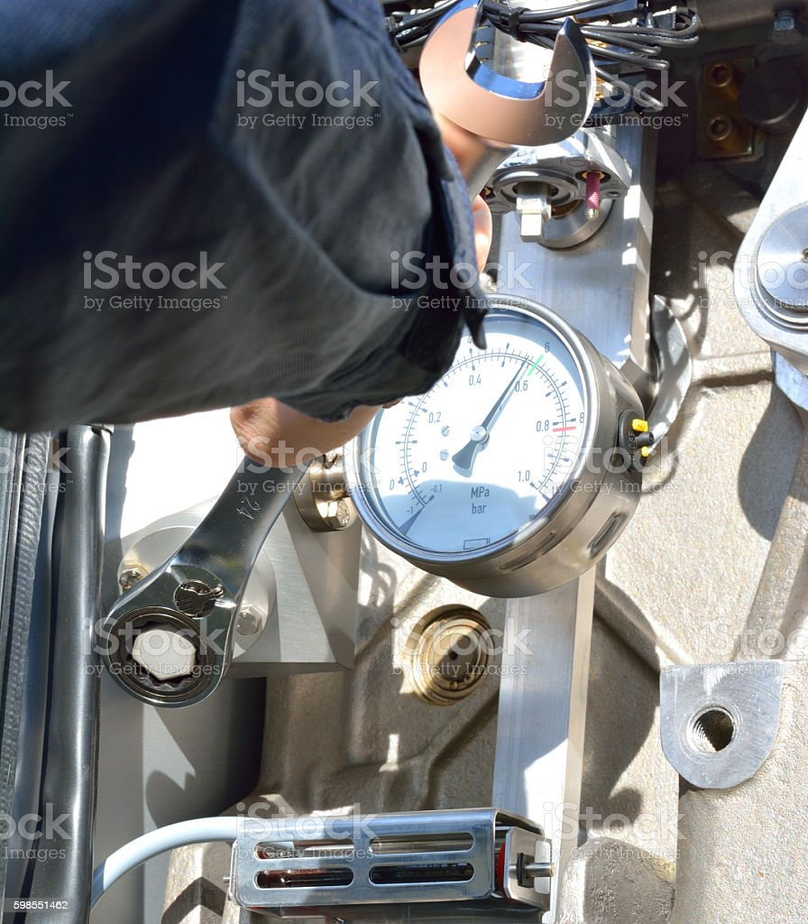 Mechanic Working with a Wrench next to the Screw stock photo