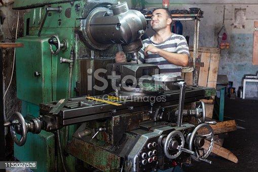 Mechanic working with lathe machine