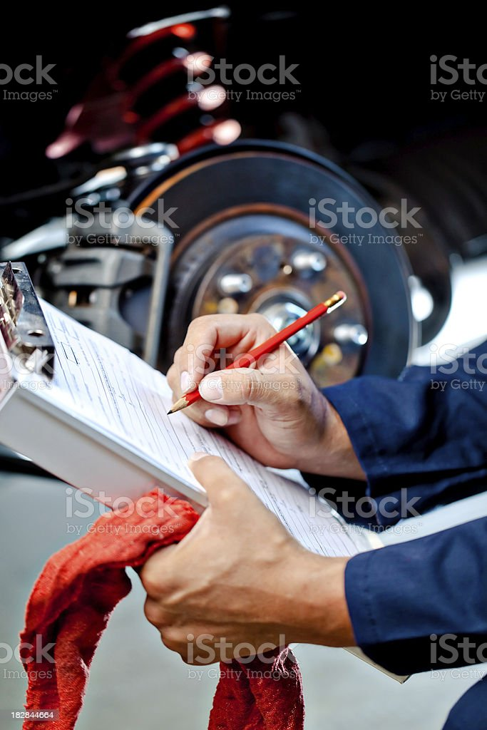 mechanic writing estimate for fix stock photo