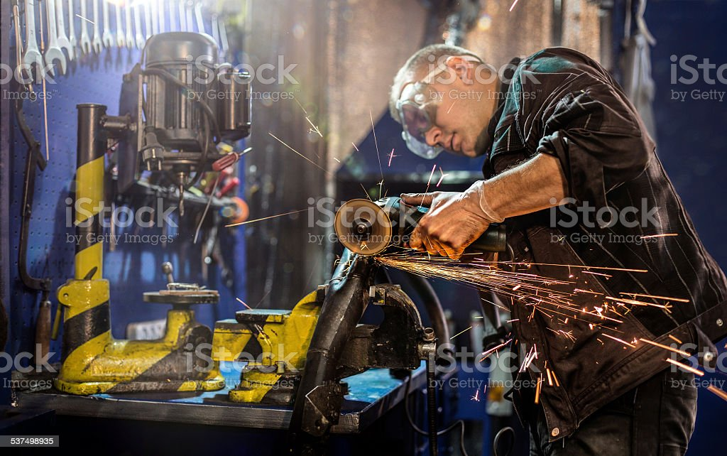 Mechanical carefully cutting tube by  grinder stock photo