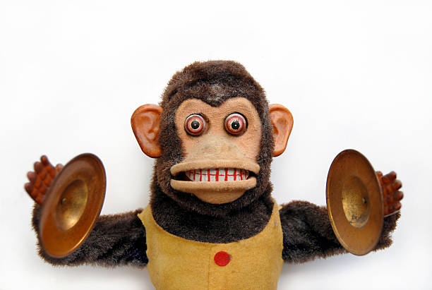 Mechanical Chimp Vintage mechanical monkey toy with cymbals cymbal stock pictures, royalty-free photos & images