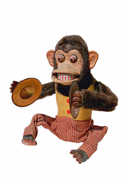 A mechanical chimp with cymbals on a white background Vintage mechanical monkey toy with cymbals, full body isolated on white background cymbal stock pictures, royalty-free photos & images