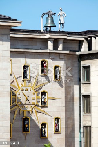 Mechanical Clock in Brussels Belgium on the side of a building