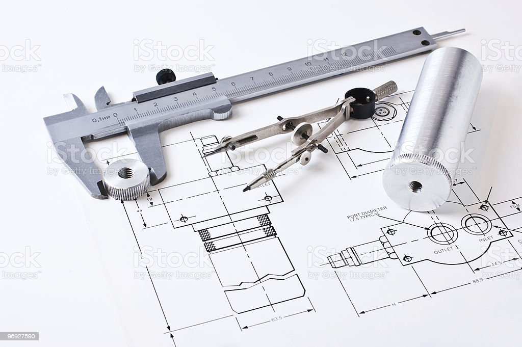 Mechanical drawing with calipers and a compass featured royalty-free stock photo