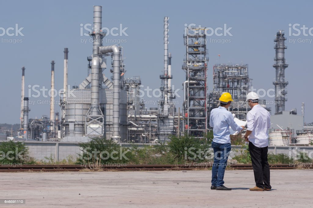 Mechanical Engineering working in Oil refinery stock photo