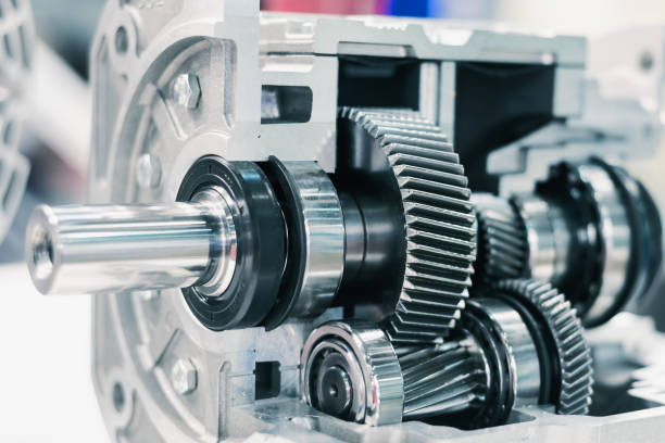 Mechanical gearbox, cross section. Helical gear. Close-up Mechanical gearbox, cross section. Helical gear Close-up ball bearing stock pictures, royalty-free photos & images