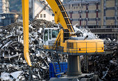 mechanical grabber at a recycling plant