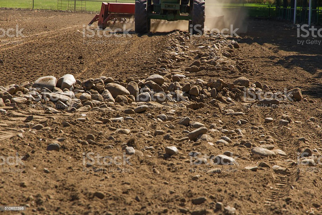 Mechanical Rake to Gather Stones of the the land stock photo