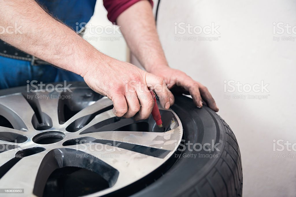 Mechanical repairs a tire royalty-free stock photo
