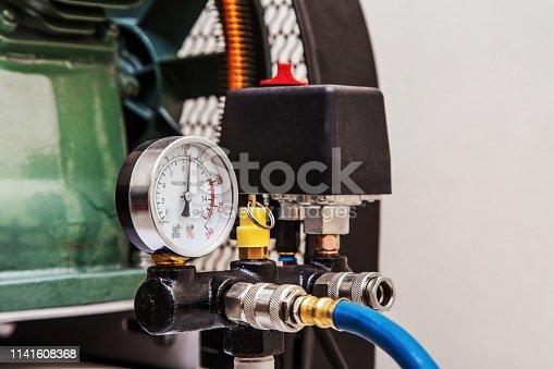 istock Mechanical sensor on the compressor 1141608368