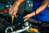 istock Mechanical specialist professional checking oil level in car engine 1165314266