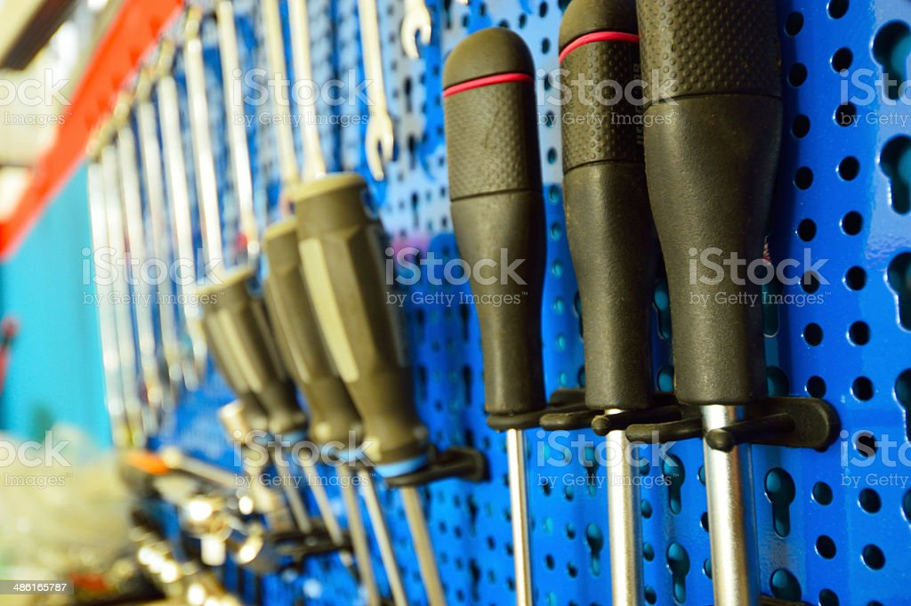 mechanical tools placed on a cupboard, screwdrivers in focus stock photo