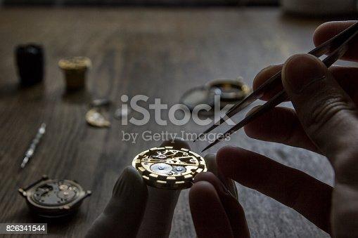 istock Mechanical watch repair 826341544