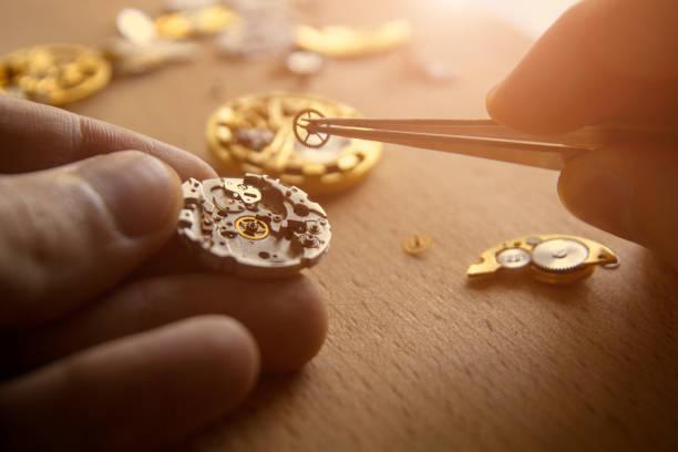 Mechanical watch repair stock photo