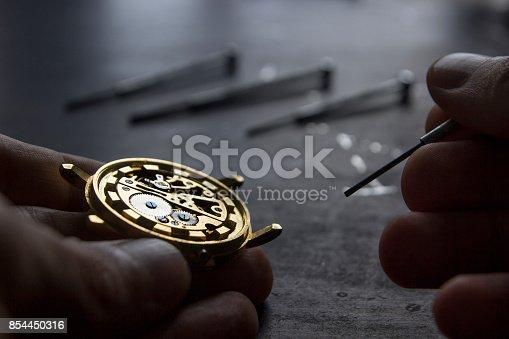 istock Mechanical watch repair 854450316