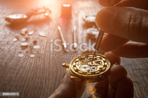 istock Mechanical watch repair 898945810